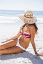 Young tanned woman wearing straw hat relaxing Royalty Free Stock Photo
