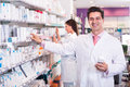 Young team in chemist shop Royalty Free Stock Photo