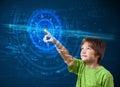 Young tech boy pressing high technology control panel screen con Royalty Free Stock Photo