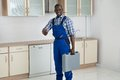 Young technician holding toolbox happy african in kitchen room Stock Images