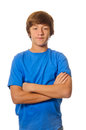 Young teen boy with arms crossed on white caucasian isolated background Royalty Free Stock Images