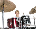 Young teen boy plays the drums in studio against white backgroun Royalty Free Stock Photo