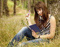 Young teen girl doing homework at the park Royalty Free Stock Photography