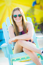 A young teen girl enjoying the sun while sitting in a beach chair Stock Images