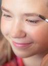 Young teen girl making make up Royalty Free Stock Photo