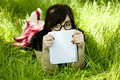 Young teen girl with notebook at green grass Royalty Free Stock Photo