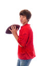 Young teen quarterback on white holding a football isolated Stock Photo