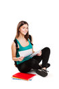 Young teen student sitting on floor with backpack Royalty Free Stock Photo