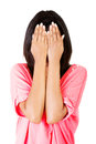 Young teen woman covering her face with hands Royalty Free Stock Photo