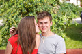 Young teen woman kissing boyfriend Royalty Free Stock Image