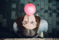 Young teenage girl blowing pink bubble gum top view of beautiful brunette Stock Images