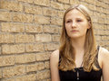 Young teenage girl looking sad or depressed Royalty Free Stock Photo