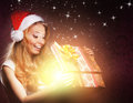 A young teenage girl opening a christmas present happy and emotional the magical box the image is taken on vintage background Stock Photography