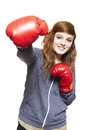 Young teenage girl wearing boxing gloves smiling on white background Stock Photos
