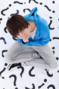 Young teenager boy with lots of questions Royalty Free Stock Photo