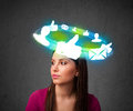 Young teenager with cloud social icons around her head Royalty Free Stock Photo