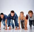 Young teens on the start position ready to run Stock Image
