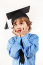 Young tired boy in academic hat on white background Royalty Free Stock Photo