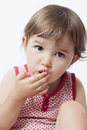 Young toddler appetite for sweets year old baby eating with gluttony Royalty Free Stock Photo