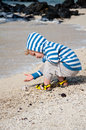 Young toddler on the beach family holiday teh tropical Royalty Free Stock Images