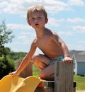 Young Toddler Boy Unsure of going down a swimming pool slide Royalty Free Stock Photo