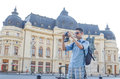 Young tourist with classic camera a takes pictures in central bucharest Stock Photography