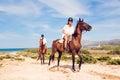 Young Tourist Couple Horseback Riding Royalty Free Stock Photo