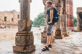 Young tourist man waits when intense rain stop on the yard of Qu Royalty Free Stock Photo