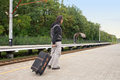 Young tourist pulling bag train station Royalty Free Stock Photo