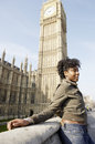 Young tourist standing by big ben in london city Royalty Free Stock Images