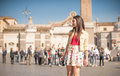 Young tourist woman in Rome smiling looking at the place Royalty Free Stock Photo