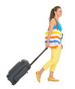 Young tourist woman wheel bag going sideways white Royalty Free Stock Images