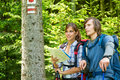 Young tourists checking the map and blaze tourist hikers Stock Images