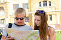 Young tourists consulting a map Stock Image