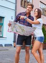 image photo : Young tourists with map