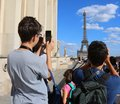 Image : Young tourists take pictures of Eiffel Tower in Paris France fro shares girls