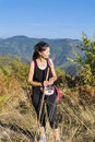 Young tourists woman in the autumn mountain Royalty Free Stock Photo