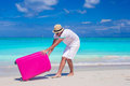 Young traveler with his luggage on a tropical beach Royalty Free Stock Photo