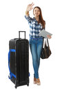 Young traveler with a huge black travel bag on wheels teen girl years old big waving his hand Royalty Free Stock Photos