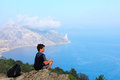 Young traveler at the mountain top looks beautiful crimean seascape from of karaul oba sudak crimea ukraine Royalty Free Stock Photography