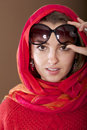 Young traveler woman with sunglasses and scarf over the shoulder Royalty Free Stock Photos