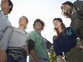 Young trendy friends looking away group of multiethnic outdoors Stock Photography