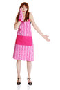 Young troubled housewife in pink apron Royalty Free Stock Photography