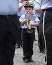 Young trumpet player parading ubeda spain september a little boy plays the in the middle of adult musicians of a fanfare during Royalty Free Stock Image