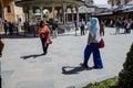 Young turkish woman photographs friends konya turkey jun in the courtyard of the mevlana shrine konya turkey Stock Photos