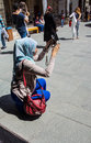 Young turkish woman photographs friends konya turkey jun in the courtyard of the mevlana shrine konya turkey Royalty Free Stock Photos