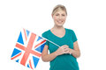 Young uk supporter holding national flag female nation s Royalty Free Stock Photos
