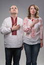 Young ukrainian couple in national dress vyshyvanka standing anthem pose Stock Photography