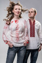 Young ukrainian couple in national dress vyshyvanka standing anthem pose Stock Images