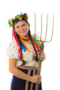 Young ukrainian girl in national dress and a wreath with pitchforks Royalty Free Stock Photos